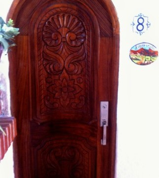 9- Carved front door